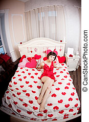 Woman in bed with hearts