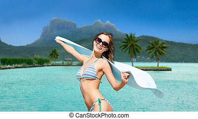 woman in bikini and sunglasses on bora bora beach