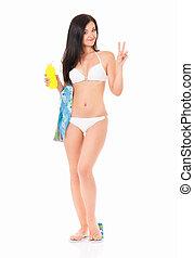 Woman in bikini applying cream