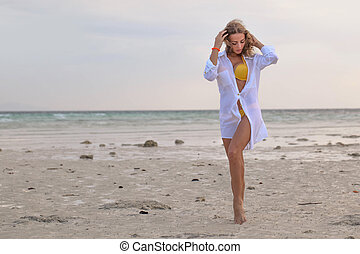 Woman in bikini at tropical beach