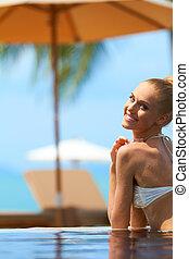 Woman in bikini at tropical resort