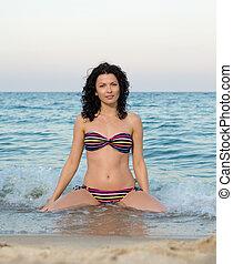 Woman in bikini in the surf