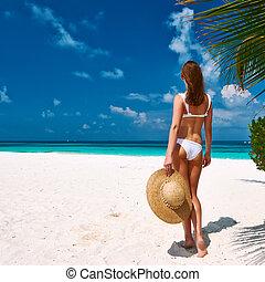 Woman in bikini on a beach at Maldives - Woman in bikini on...