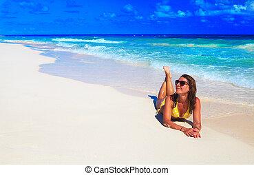 Woman in bikini on the beach.
