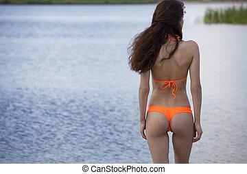 Woman in bikini on the beach