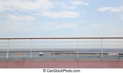 woman in bikini runs on deck of cruise ship