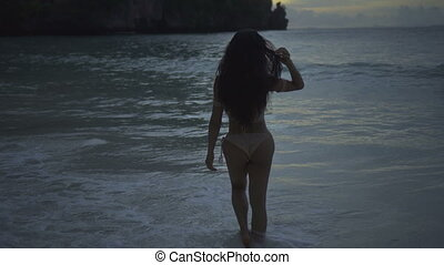 Woman in bikini walking in the sea
