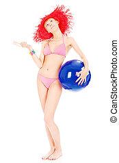 Woman in bikini with ball