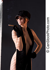 woman in black astrakhan smoking cigar - sexy woman in black...