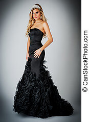 Woman in Black Ball Gown Dress. - Glamourous woman wearing a...