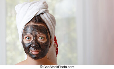 Woman in black cosmetic mask