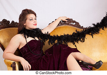 Woman in black dress and black boa
