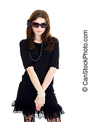 Woman in black dress and sunglasses