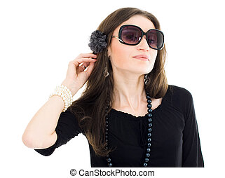 Woman in black dress and sunglasses listen