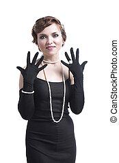 Woman in black dress gesticulating