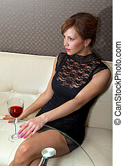 woman in black dress on sofa ll