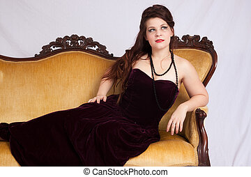 Woman in black dress reclining
