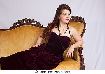 Woman in black dress reclining