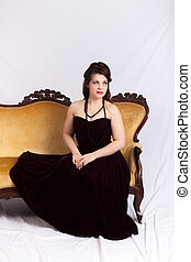 Woman in black dress sitting