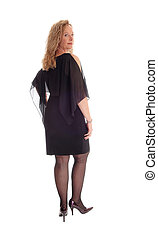 Woman in black dress standing from back.