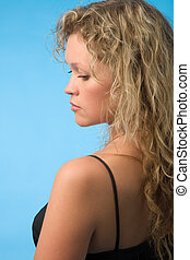 woman in black dress - young blond woman in black dress on...