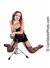 Woman in black fishnet stockings with stool