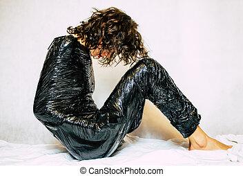 Woman in black foil