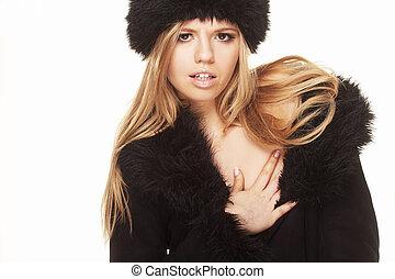 Woman in black fur hat and coat