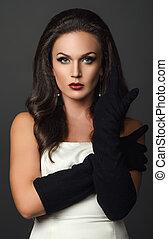 woman in black glove studio portrait