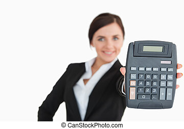 Woman in black suit showing a calculator
