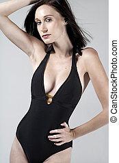 Woman in black swim suit