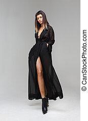 Woman in black transparent nightie underwear