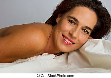 Woman in black underwear lay on bed