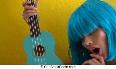 Woman in blue bikini and wig - Closeup portrait of sexy...