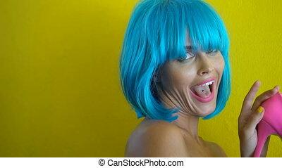 Woman in blue bikini and wig - Side view closeup portrait of...