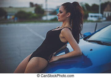 woman in blue car