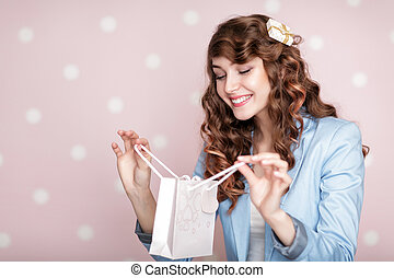 woman in blue jacket holds gift box. - beautiful smiling...