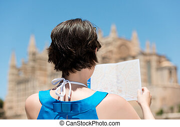 Woman in blue looks at map