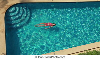 Woman In Blue Pool. Top View