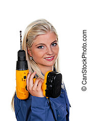 Woman in blue work clothes with a drill