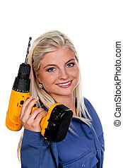 woman in blue work clothes with drill
