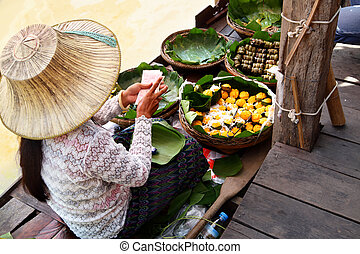 Floating Market - Woman in boat at Floating Market, Thailand