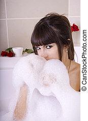 Woman in bobble bath