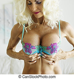 Woman in bra. - Tan Caucasion blonde middle-aged woman in...
