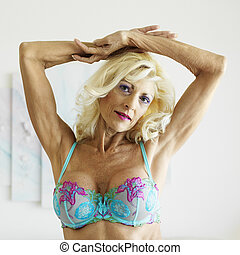 Woman in bra. - Tan Caucasion blonde middle-aged woman...