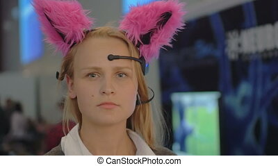 Woman in brain-controlled cat ears - Slow motion and close-...