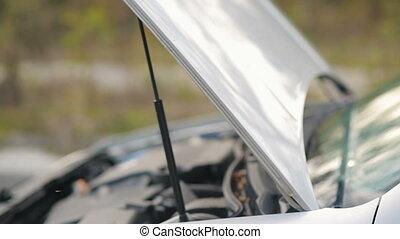 Woman in broken car