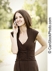 Woman in brown with mobile