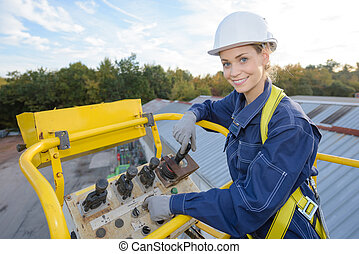 Woman in bucket of cherry picker