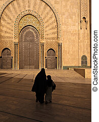 Woman in burka and child walking